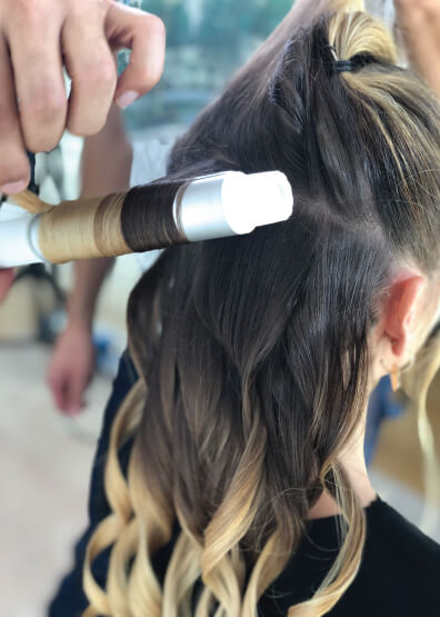 Models Hair Being Curled With Wand