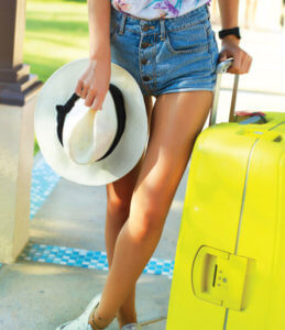 Model with suitcase