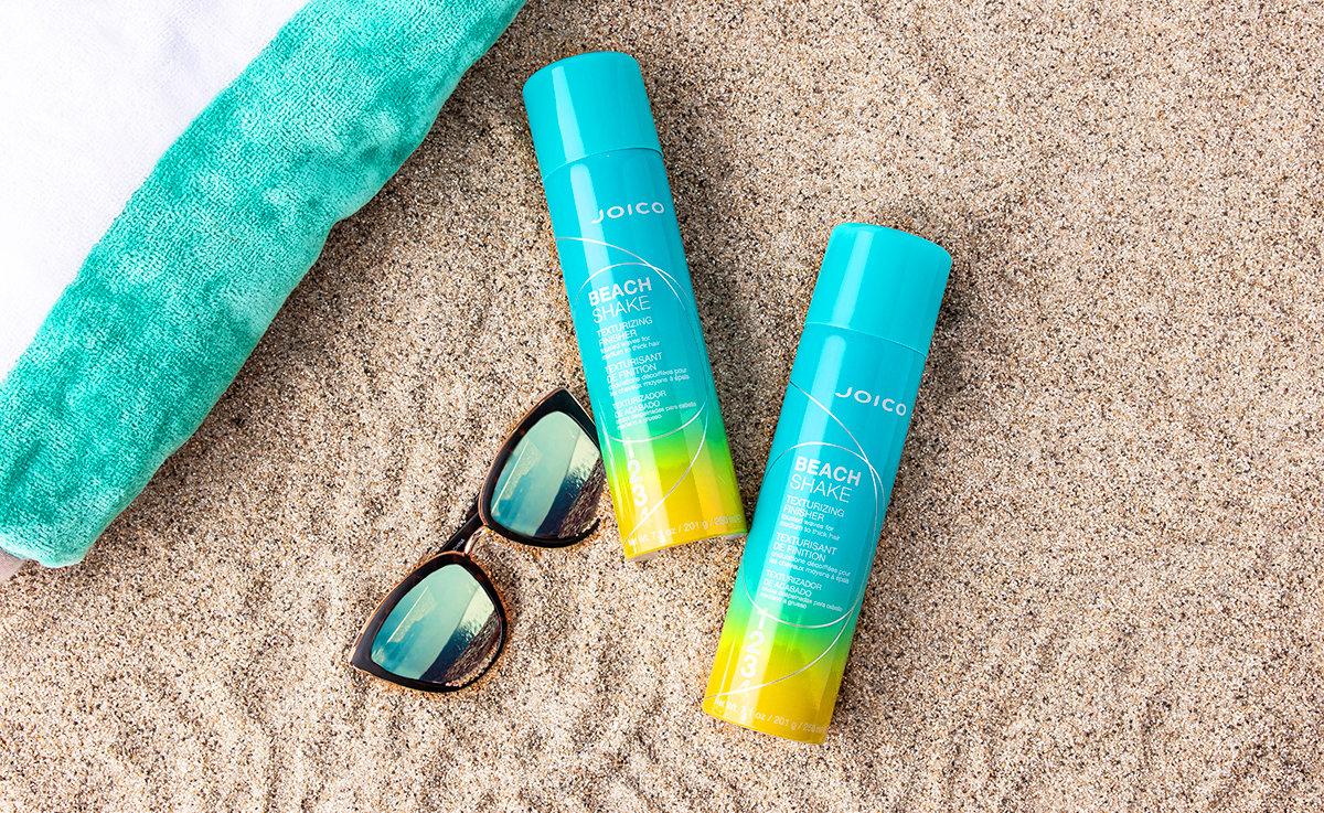 Joico beach shake bottles in sand