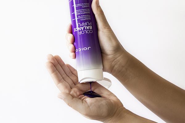 Joico Color Balance Purple Shampoo in hand