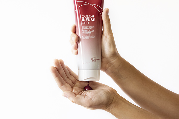 Joico Color Infuse Red Conditioner in hand