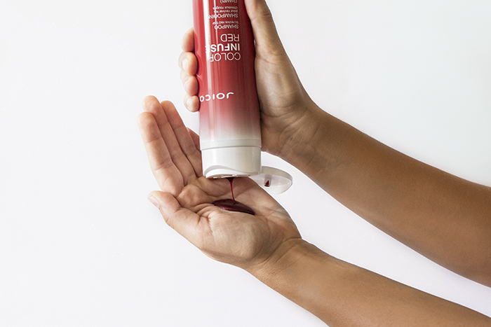 Joico Color Infuse Red shampoo in hand