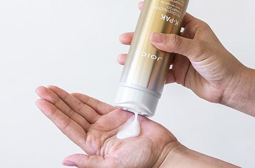 K-PAK Reconstructing Shampoo in hand