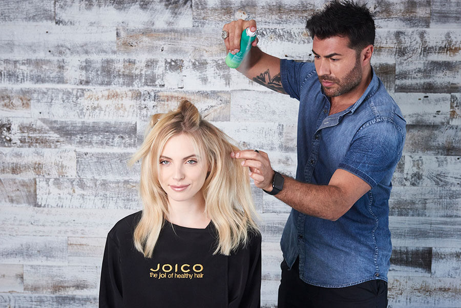 Richard Mannah styling models hair