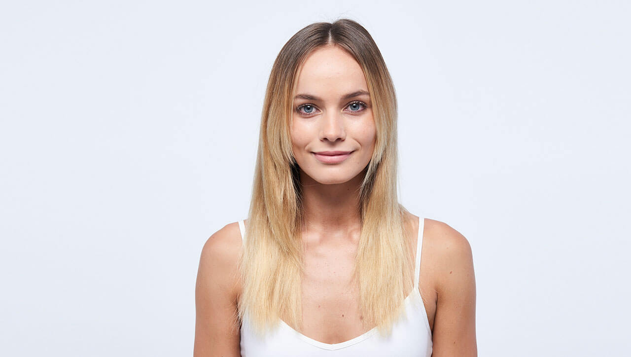 Sunkissed coastal blonde hair color technique model before