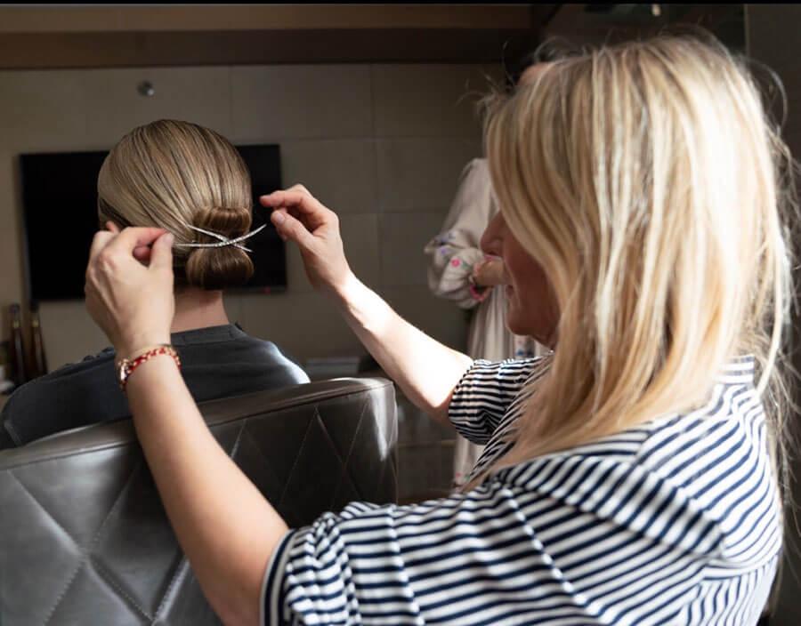 Emily Blunt having hair styled for SAG Awards