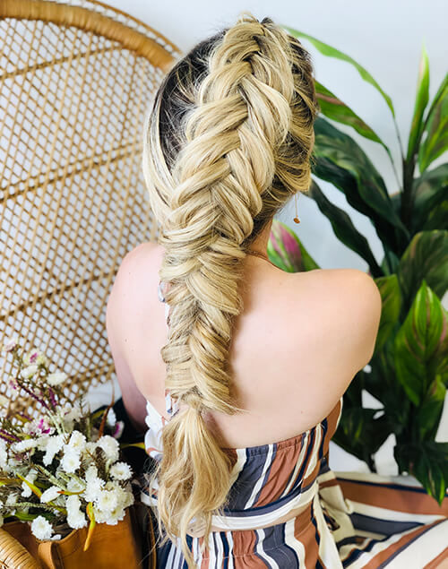 Models thick long hair braided to the back