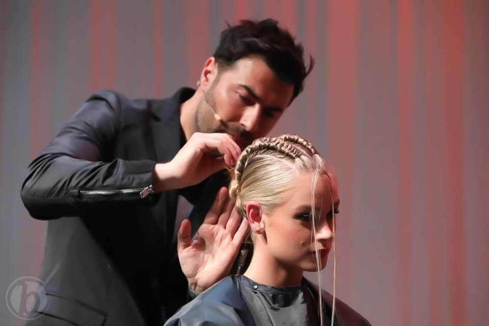 Richard Mannah Braiding models hair for BTC Show