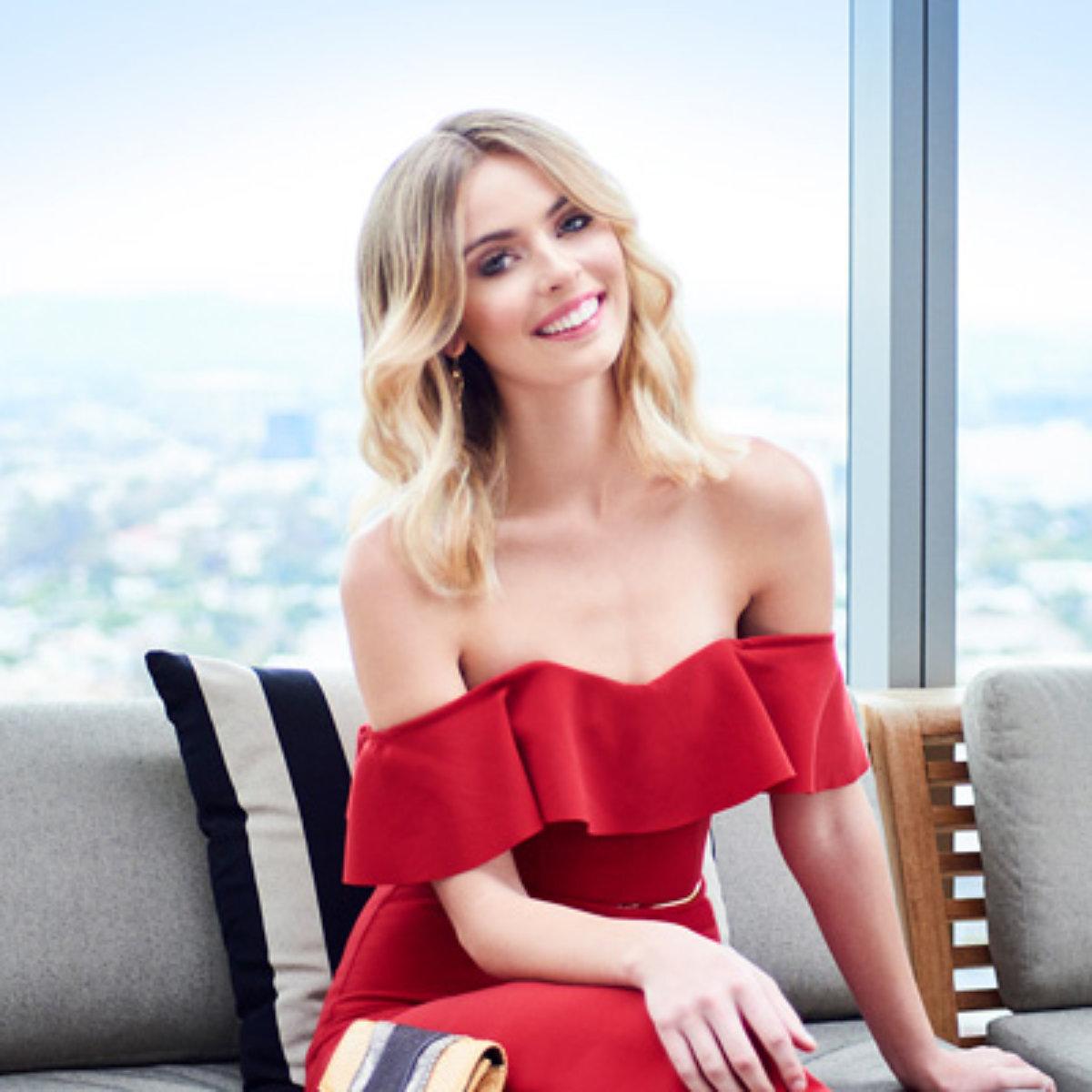 Beautiful blonde smiling wearing a red dress