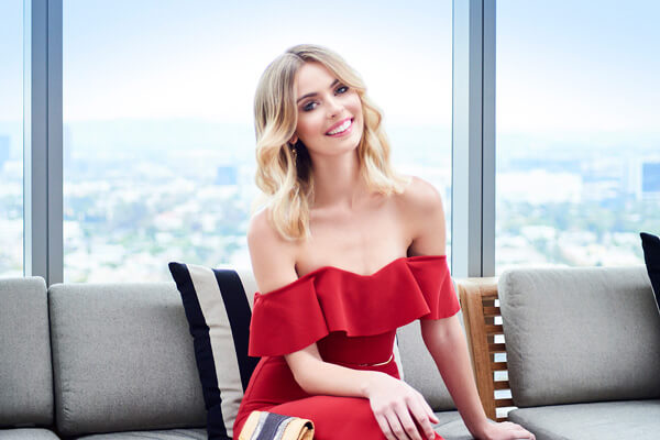 Beautiful blonde smiling wearing a red dress