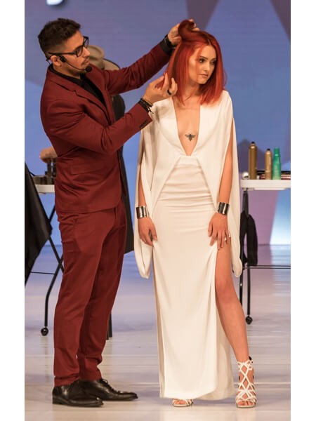 Ricardo styling models hair at Premier Orlando