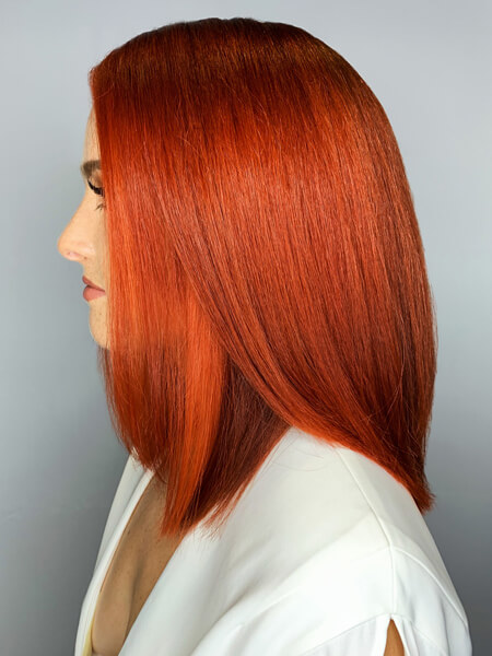 Model with freshly colored vibrant red hair