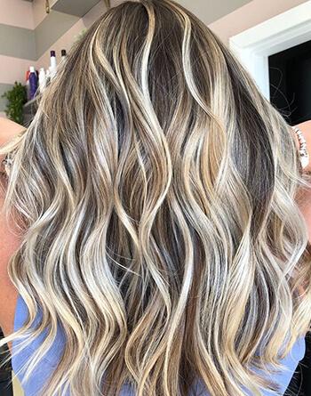 Demensional blonde hair color on model