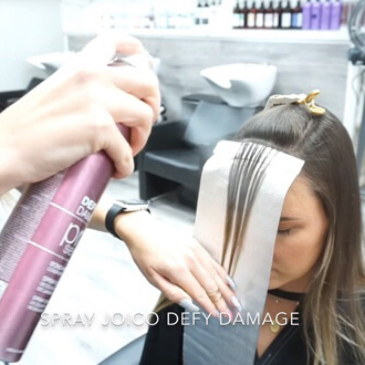 Womens Hair being colored with hair dye
