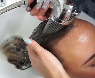Womens Hair being shampooed in sink