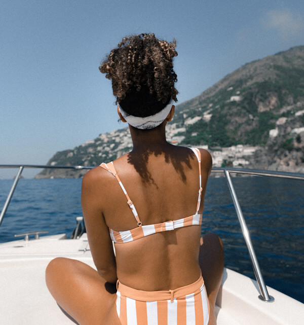 Brunette sitting on a boat overlooking an ocean view