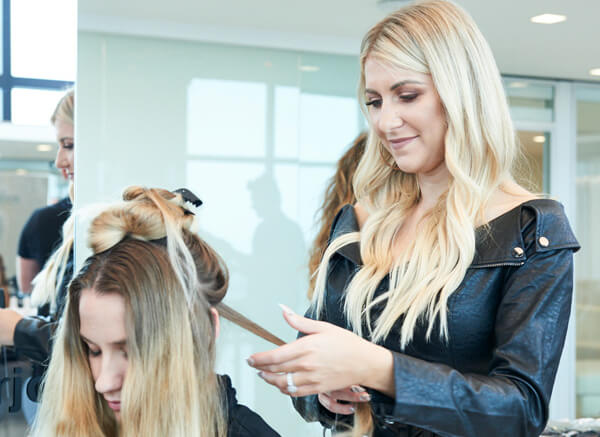 Olivia Smalley giving client a haircut