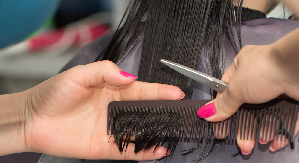 Women getting her ends trimmed in salon