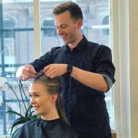 Chad Demchuck cutting clients hair