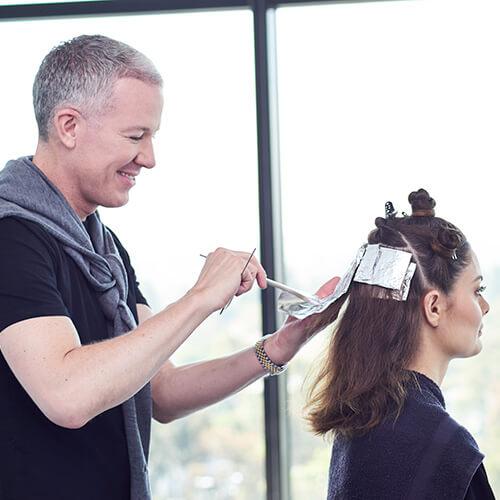 Hair Dresser coloring womens hair