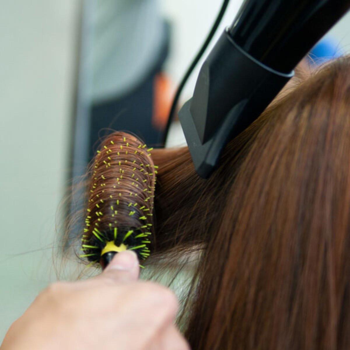 Hair being Blowdried with round brush