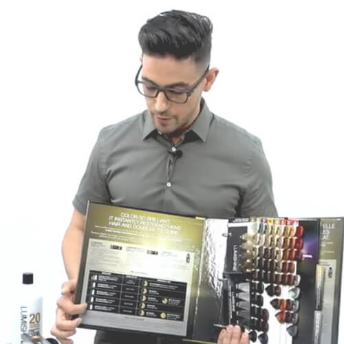 Hiar stylist showing different hair color swatches