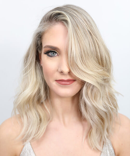 Blonde women showing hair after being colored