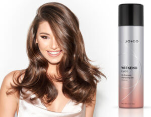 Model showing full volumious hair and Joico Dry Shampoo bottle