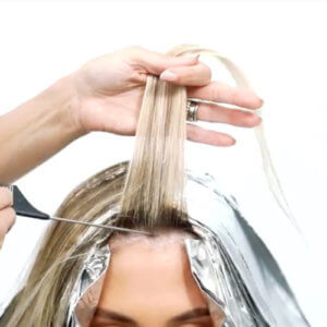 Womens hair being colored at the roots