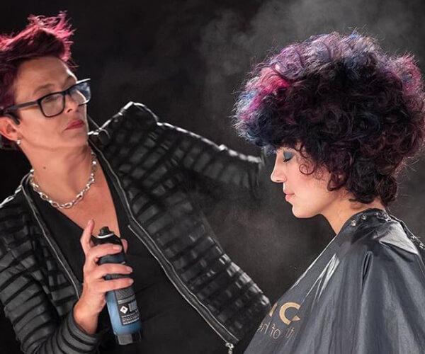 Hairdresser styling models hair