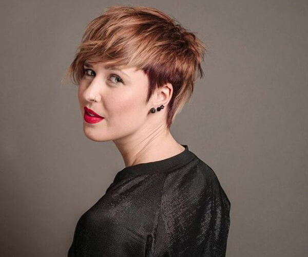 Women showing short brunette pixie haircut with red and blonde highlights