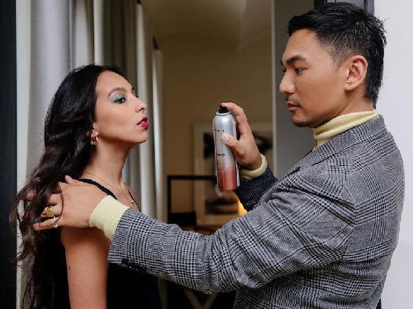 Hair stylist styling womens hair
