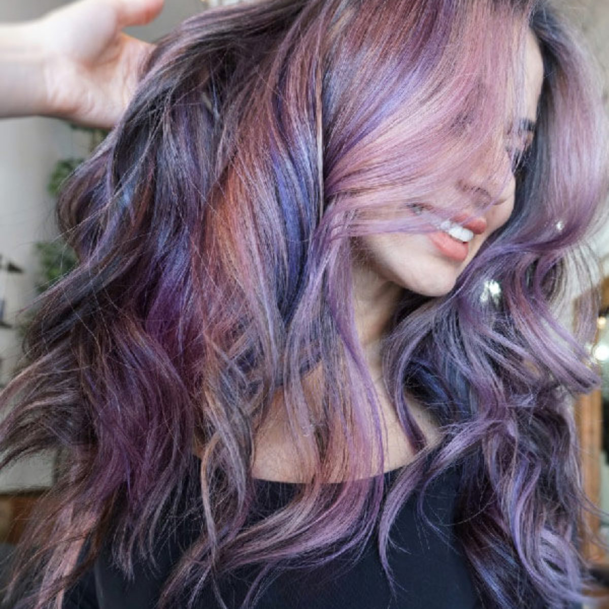 Model with purple hair highlights