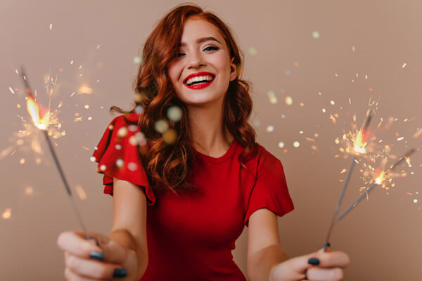 Women smiling with sparklers in hand