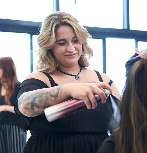 Hair dresser prepping hair
