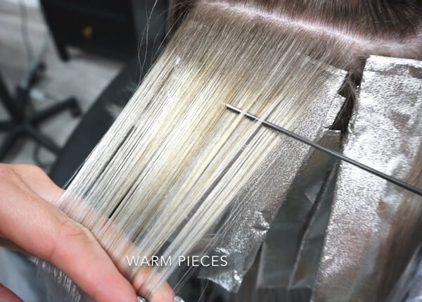 Hair being foiled with hair color