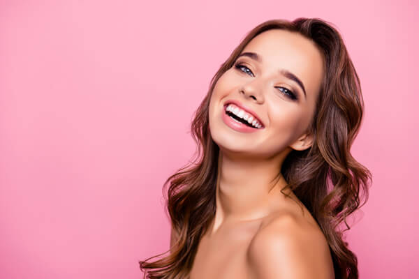 Brunette girl with wavy hair smiling