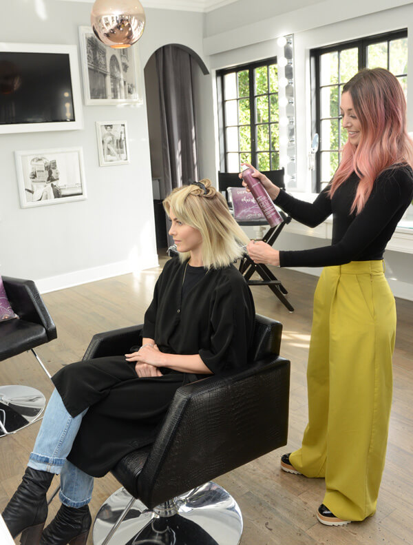 Celebrity stylist Jill Buck coloring clients hair