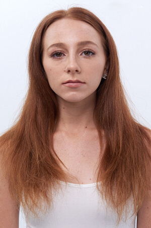Model with red hair before haircut