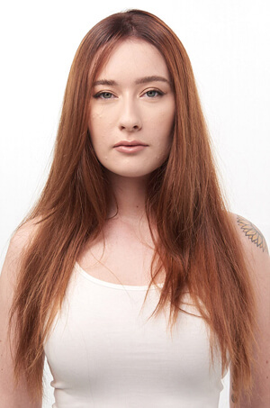 Auburn hair model before haircut