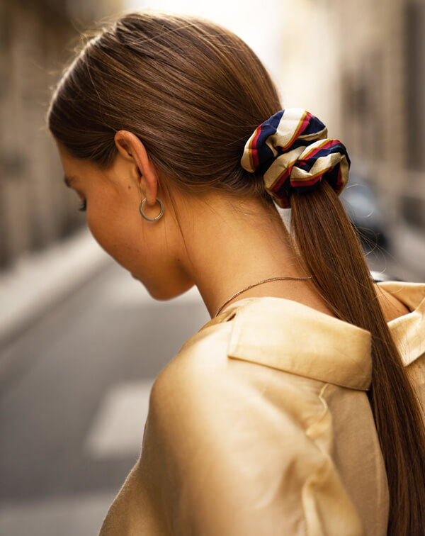 Woman with schrunie in hair