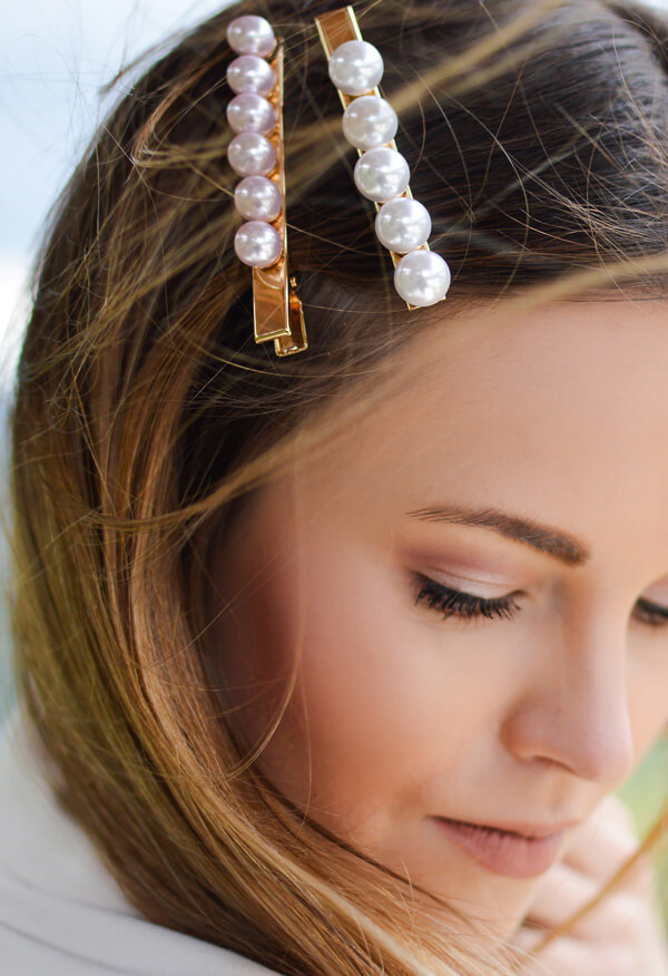 Woman with pearl barrettes in hair