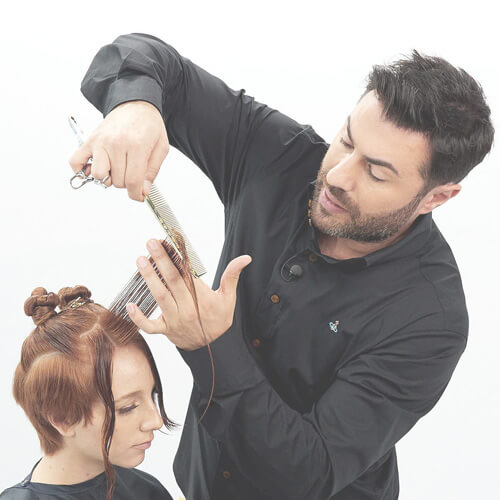 Richard Mannah cutting clients hair