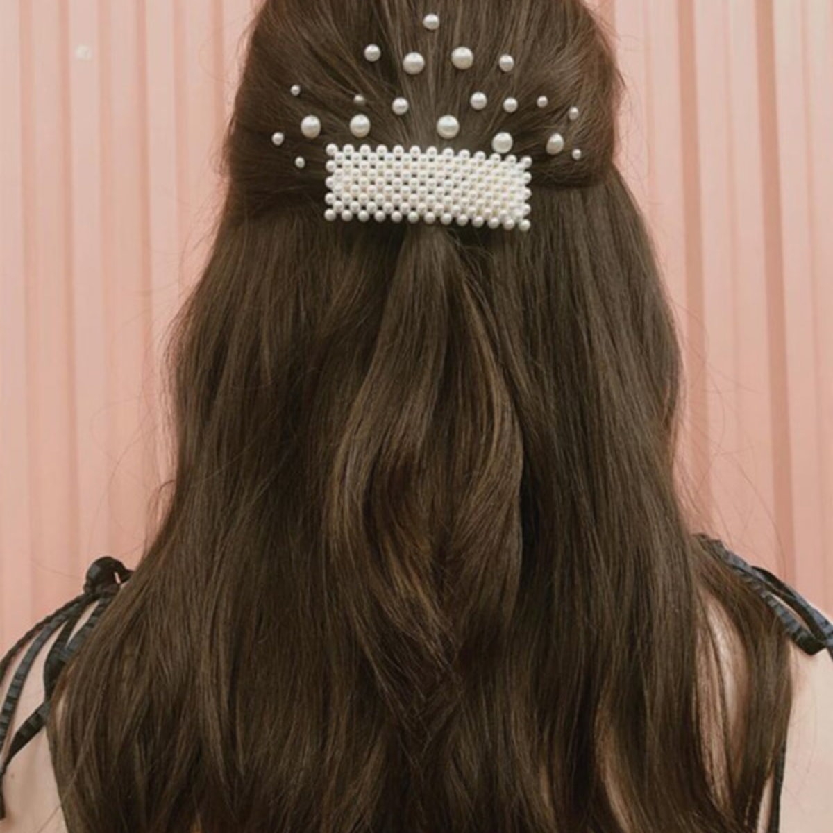 Brunette with pearl barret in hair