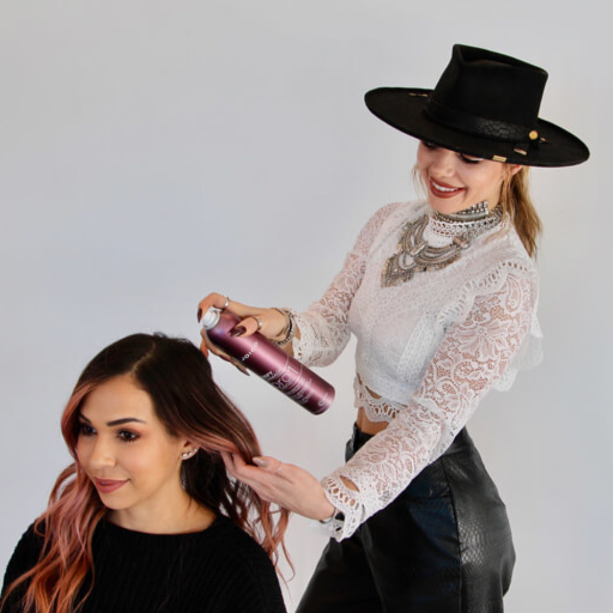 Larisa Love styling clients hair