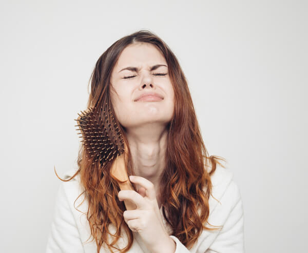 Women brushing tangled hair