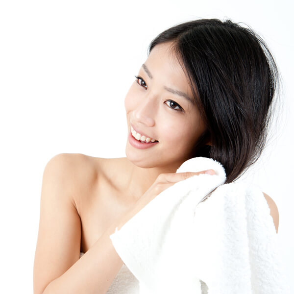 Women towel drying wet hair