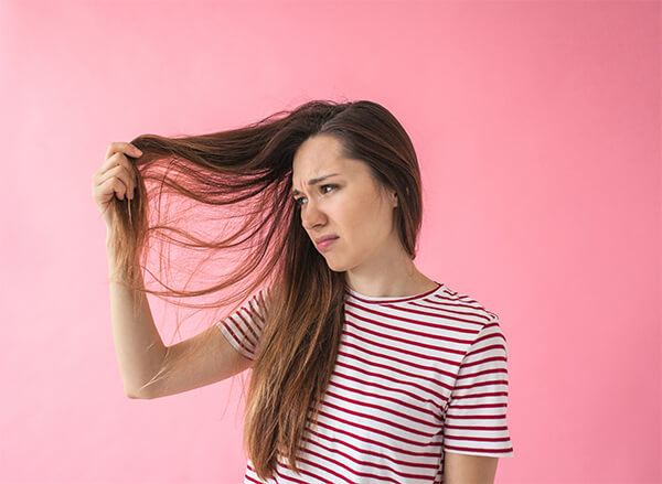 Women looking at tangled hair