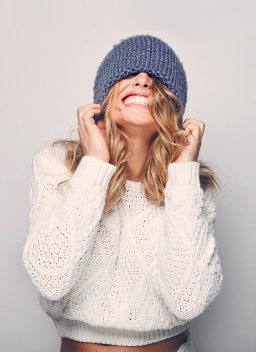 Women with beanie on smiling