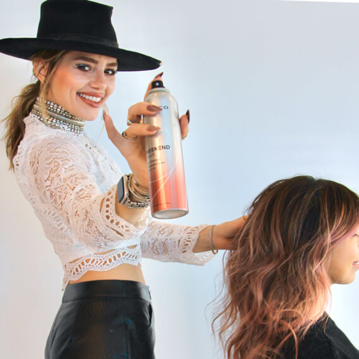 Stylist Larisa Love styling clients hair
